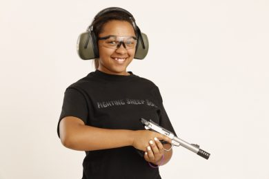 young girl with semi-auto pistol