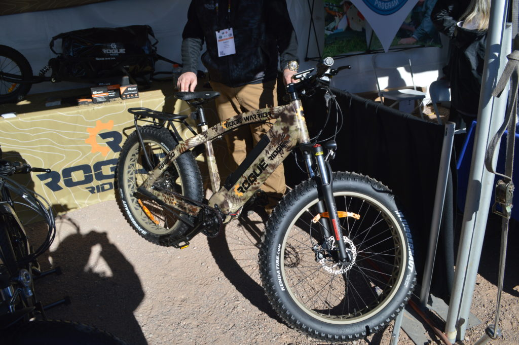 The Rogue Ridge E-Bike in Kryptek camo is built for hunters. With extra fat tires, a 50-mile range battery pack, solar charger, and optional trailer for hauling gear and game, this is an active hunter's dream. (Photo: Kristin Alberts/Guns.com