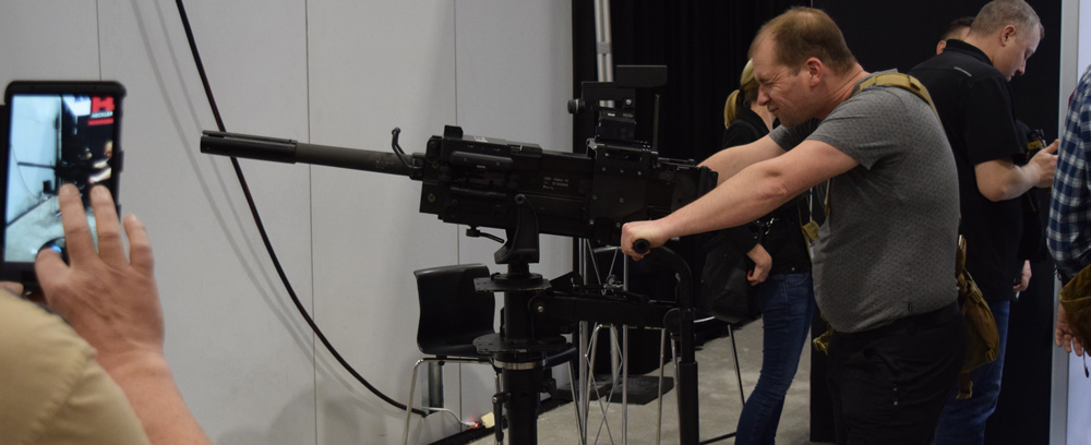 Everybody wants a picture with the MK19 at the Heckler & Koch booth during SHOT Show 2018 in Las Vegas. (Photo: Daniel Terrill/Guns.com)