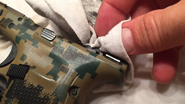 Cleaning the gun is part of the living the lifestyle. (Photo: Eve Flannigan)